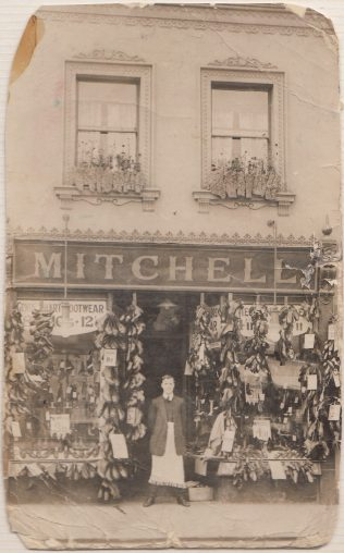 Valerie's father outside the shoe shop he managed in Tredworth.
