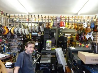 Mark with a range of stock sold in his shop | Ollie Taylor